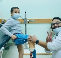 Anan gets his prosthetics adjusted