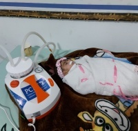 Gaza Refugee Child Gets Suction Device to help Breath