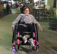 Dallas Community Provides Paralyzed Child Wheelchair