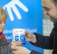 PCRF Distributes Special Milk for Disabled Children in Gaza
