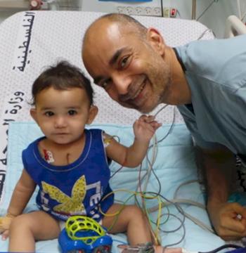 Dr. Adil Husain