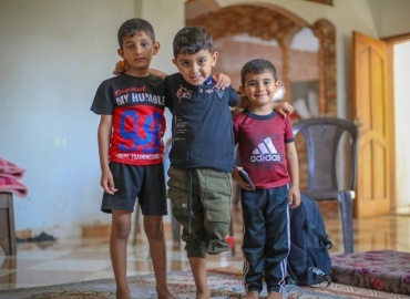 Five-year-old Yazan, who lost his leg last month from a bombing, is visited by PCRF's staff