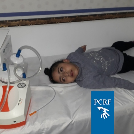 PCRF Provide Suction Machine to Child in Gaza