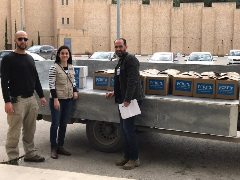 Dr. Aziza Nassar, delivered donated infection control materials to the Vice Governor of Nablus